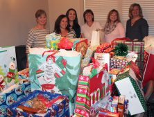 Corporate Delivering Gifts to Volunteers of America
